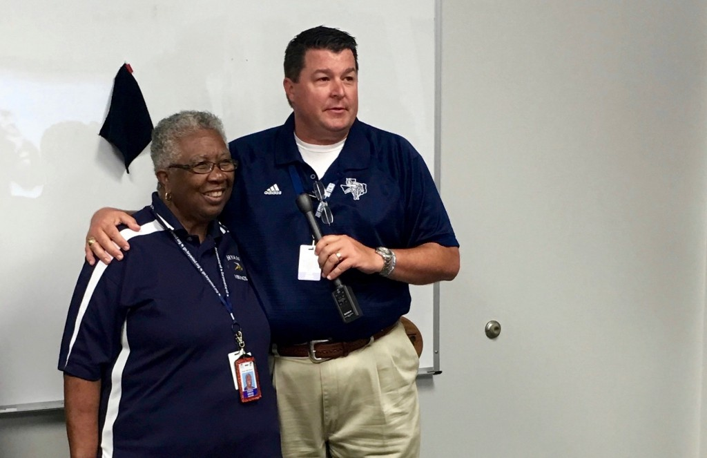 SMILING FACES - Bryan High Principal Lane Buban speaks glowingly about Coach Gregg at her 50 years of service presentation.